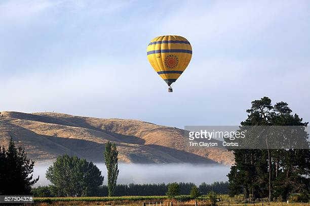 A hot air balloon in flight over the Hawkes Bay region of the North Island of New Zealand The flights provide pristine views and spectacular scenery...