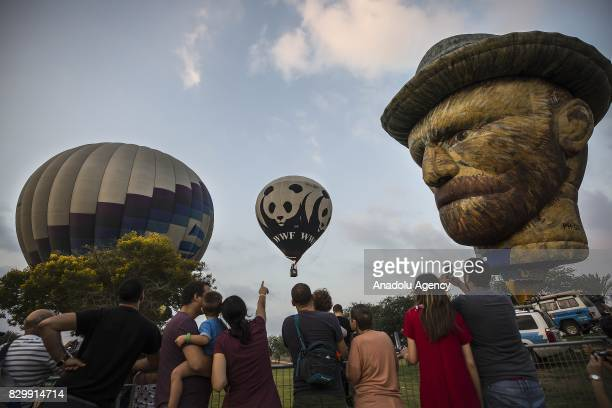 A hot air balloon in the form of Dutch painter Vincent Van Gogh flies during the 6th edition of annual International Hot Air Balloon Festival at...