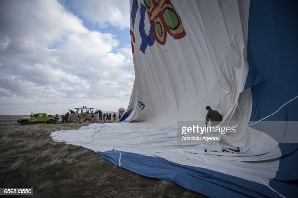 A hot air balloon is being prepared as Anadolu Agency's Visual News EditorinChief Ahmet Sel NOOR Images photojournalist Yuri Kozyrev founder of...