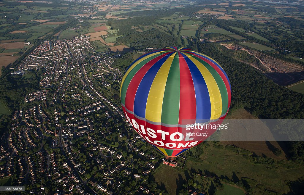 A hot air balloon is seen above Bristol as it flies from the Bristol International Balloon Fiesta main arena at the Ashton Court estate on August 7, 2015 in Bristol, England. The early morning flight of over 100 balloons was the first mass ascent of the four-day Bristol International Balloon Fiesta which started yesterday. Now in its 37th year, the Bristol International Balloon Fiesta is Europe's largest annual hot air balloon event in the city that is seen by many balloonists as the home of modern ballooning.