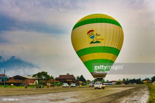 Hot air balloon landing on airfield, Vang Vieng, Laos