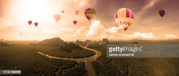 hot air balloon on sky above islands in southern thailand at the most mangrove forest in east asia . - islands in the sky stock pictures, royalty-free photos & images