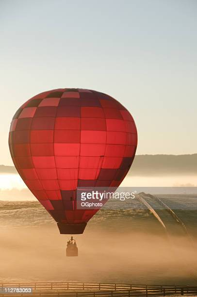 hot air balloon over a ranch - ogphoto stock photos and pictures
