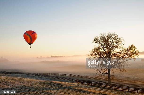 hot air balloon over a ranch - ogphoto stock pictures, royalty-free photos & images