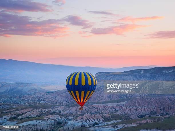 Hot air balloon over Cappadocia, Turkey at dawn