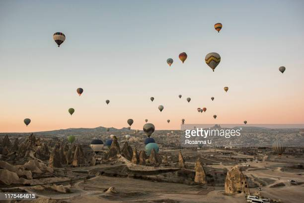 hot air balloon over göreme, cappadocia, turkey - turkey middle east stock pictures, royalty-free photos & images
