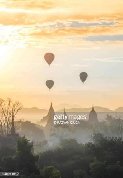 Hot air balloon over pagodas