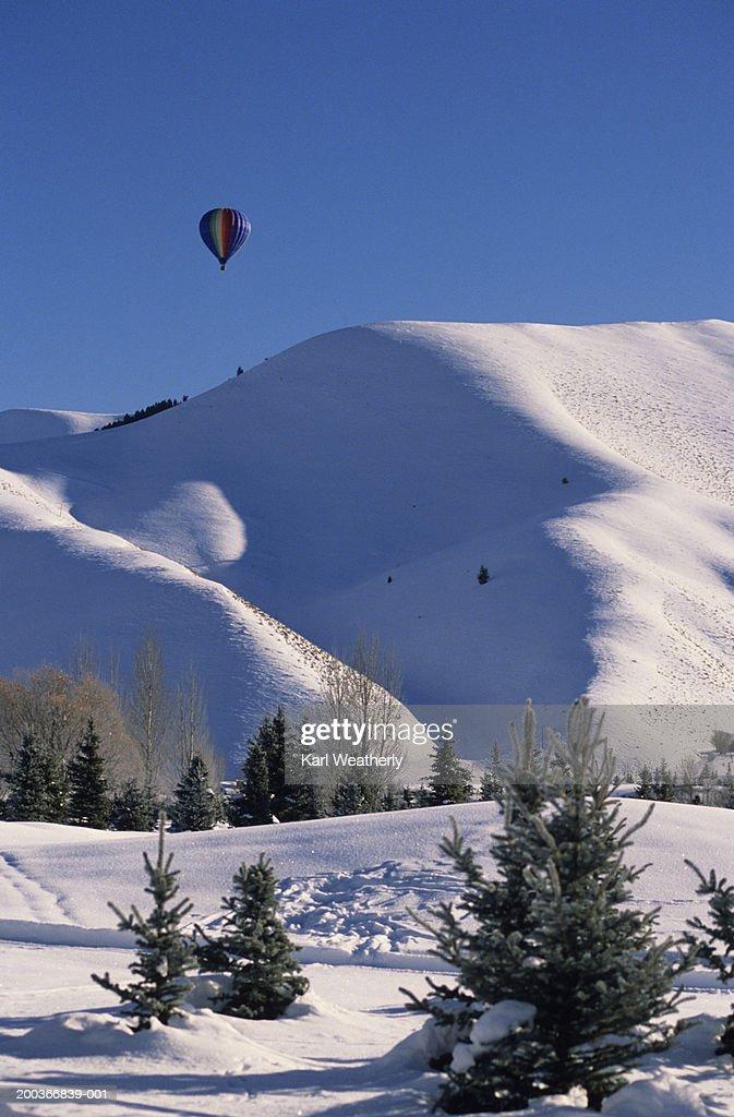 Hot air balloon over Snowy Mountains,  Sun Valley, Idaho, USA : Stock Photo