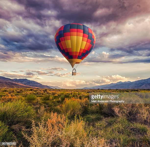 hot air balloon over the landscape - sagebrush stock pictures, royalty-free photos & images