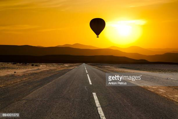 Hot Air Balloon over the scenic desert road