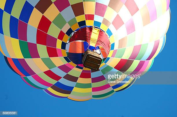 A hot air balloon pilot gets a bird's eye view of the city at the 34th annual Albuquerque International Balloon Fiesta on October 1 2005 in...