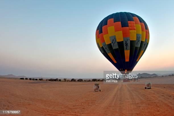 Hot air balloon ready to start a flight over the Namib Desert. Sossusvlei area. Sesriem. Namibia.