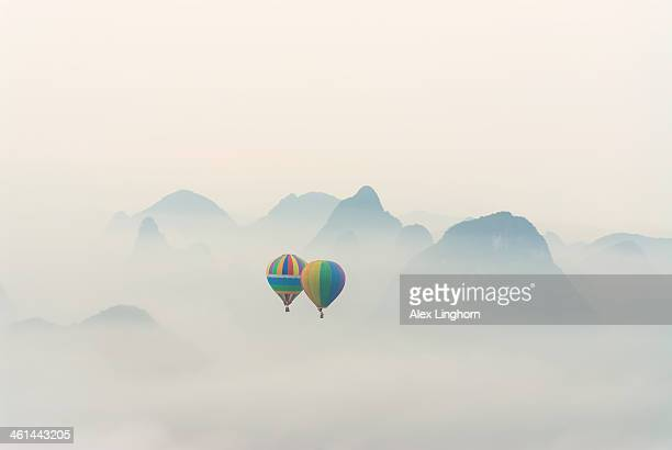 Hot air balloon ride at dawn over Karst mountains
