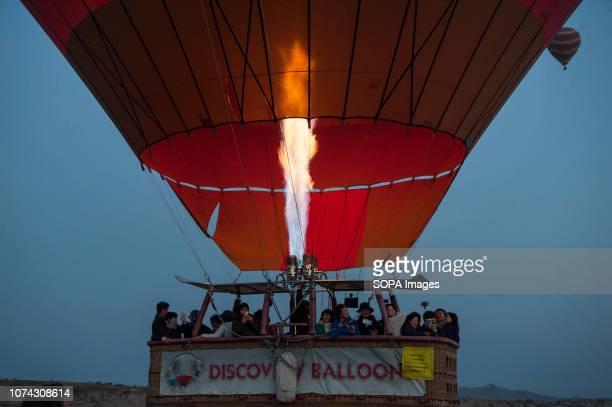 Hot air balloon seen taking off at dawn in Cappadocia