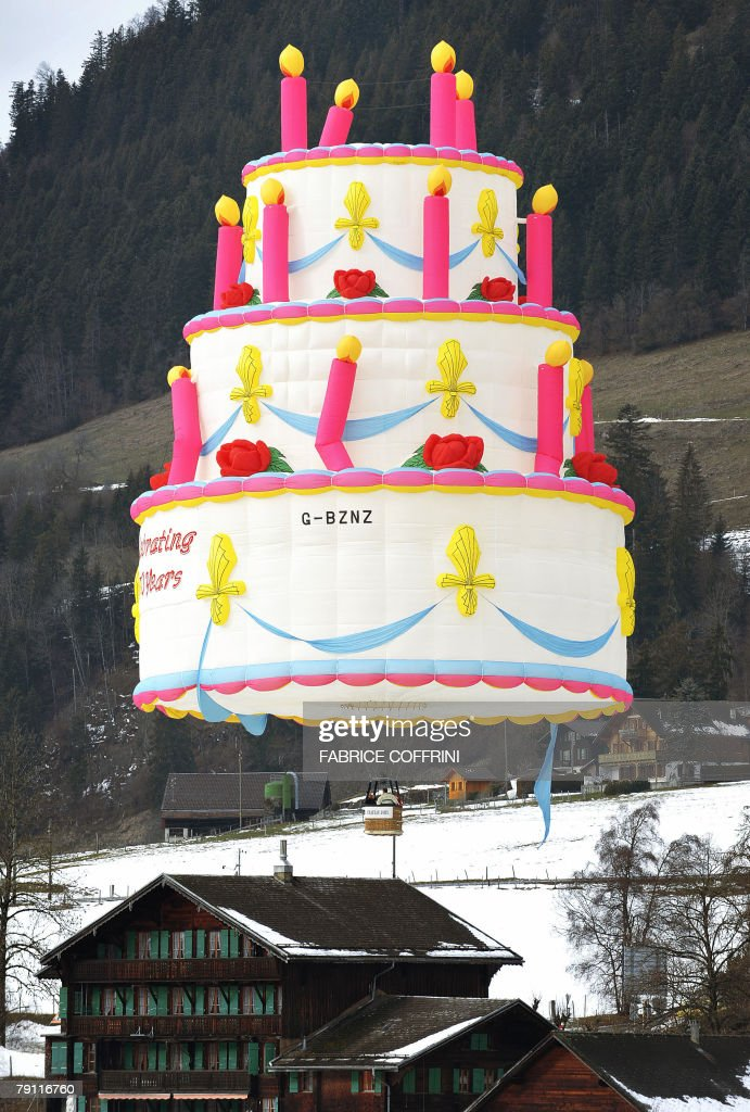 Swell A Hot Air Balloon Shaped As A Birthday Cake Flies Above The Swiss Funny Birthday Cards Online Necthendildamsfinfo