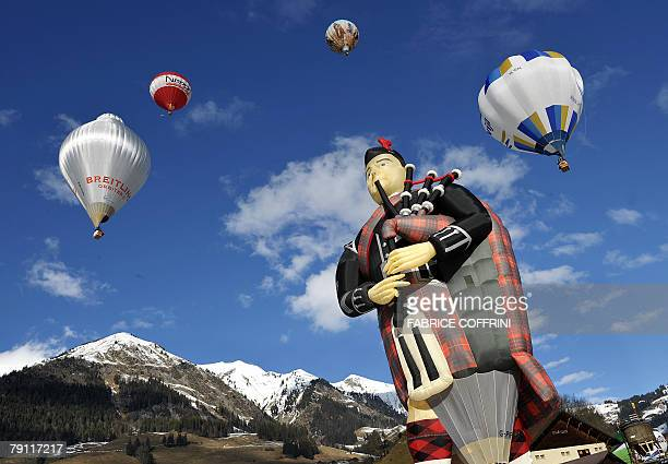 A hot air balloon shaped as a piper is ready to take off in the Swiss Alps resort of Chateau d'Oex 19 January 2008 on the opening day of the 30th...