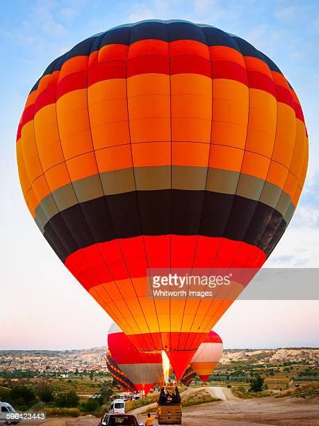 Hot air balloon takes off, dawn, Cappadocia Turkey