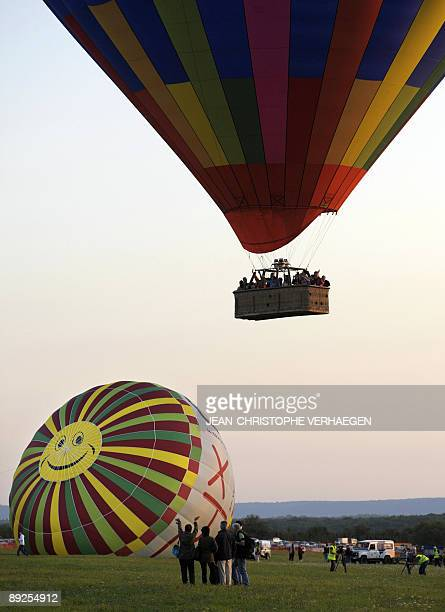 A hot air balloon takes off on July 25 from the ChambleyBussieres aerodrome eastern France during the 'Lorraine Mondial Air Ballons' world biggest...