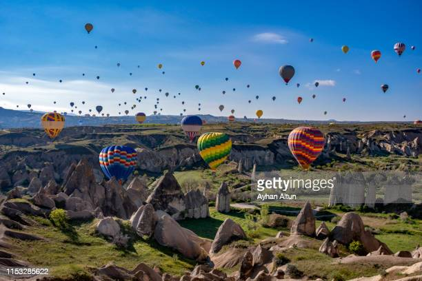 hot air ballooning in cappadocia, nevsehir, central anatolia of turkey - cappadocia stock pictures, royalty-free photos & images