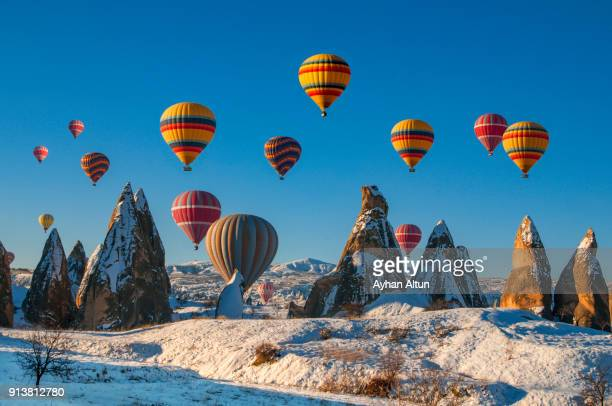 hot air ballooning in cappadocia,nevsehir,central anatolia of turkey - cappadocia stock pictures, royalty-free photos & images