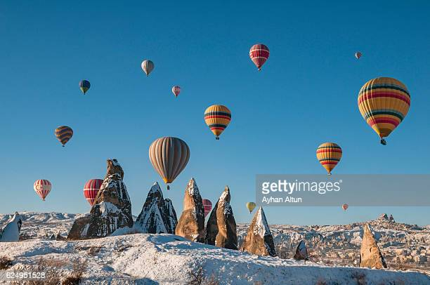 Hot Air Ballooning over fairy chimneys at winter,Goreme, Cappadocia,Turkey