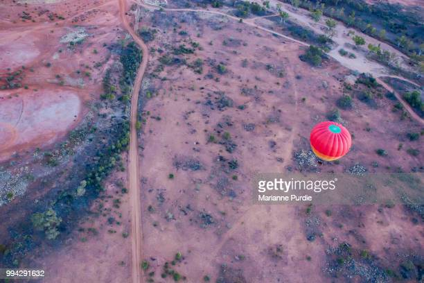 hot air ballooning over the desert - alice springs stock pictures, royalty-free photos & images