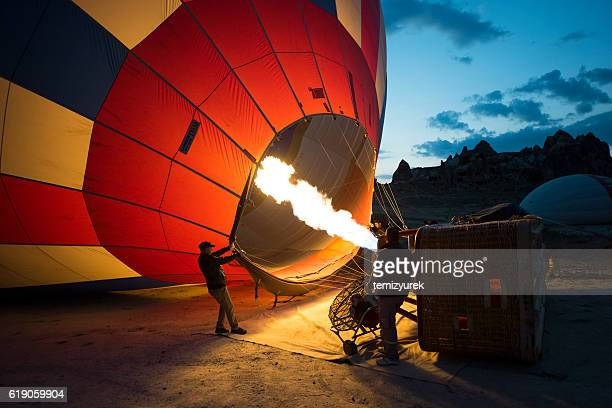 hot air balloons and workers - hot air balloon stock pictures, royalty-free photos & images