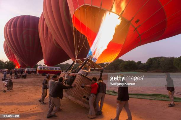 Hot air balloons are being prepared in the early morning to fly over Bagan Myanmar