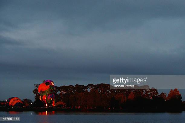 Hot air balloons are inflated at Innes Common Park during the Balloons over Waikato Festival on March 27 2015 in Hamilton New Zealand Balloon...