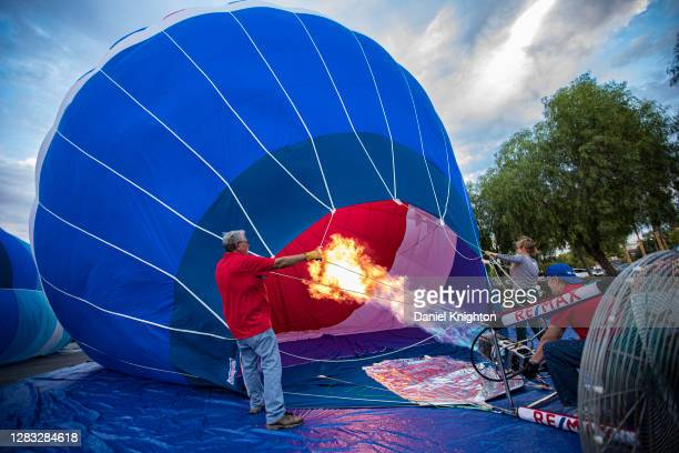 Hot air balloons are inflated prior to the Hot Air Halloween Balloon Glow on October 31, 2020 in Temecula, California. As the coronavirus pandemic...