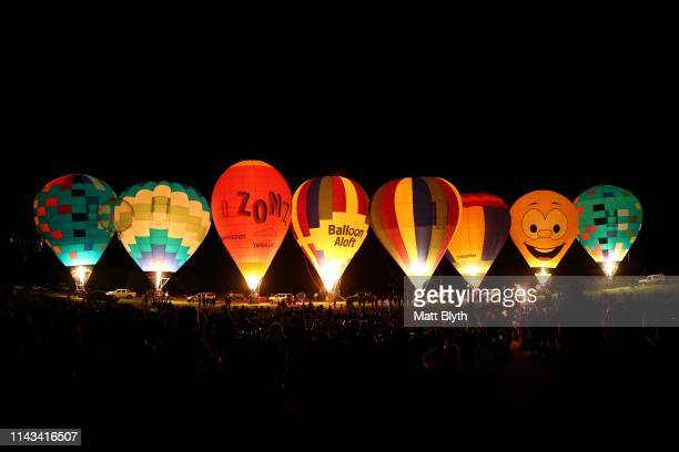 Hot air balloons are seen during the Hunter Valley Night Glow at Roche Estate vineyards on April 13 2019 in Pokolbin Australia