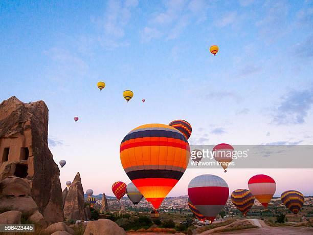 hot air balloons at dawn in cappadocia - cappadocia stock pictures, royalty-free photos & images