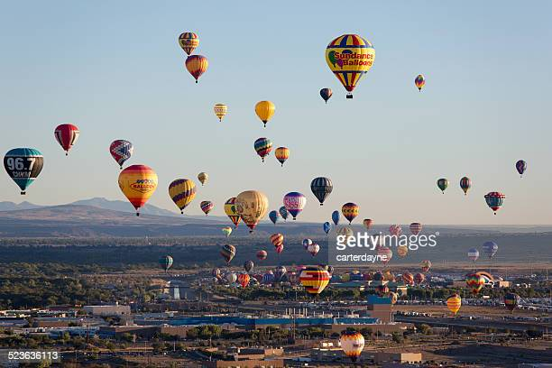hot air balloons at sunrise albuquerque new mexico - balloon fiesta stock pictures, royalty-free photos & images