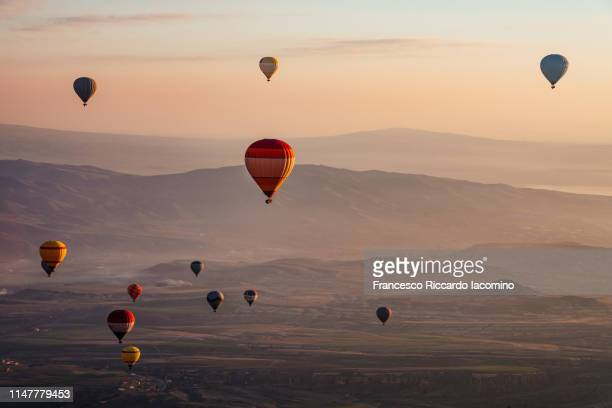 hot air balloons at sunrise in cappadocia - balloon ride stock pictures, royalty-free photos & images