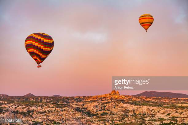 Hot air balloons at sunrise over the beautiful landscape in Cappadocia, Turkey