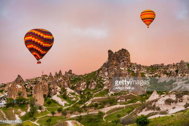 Hot air balloons at sunrise over Uchisar in Cappadocia, Turkey