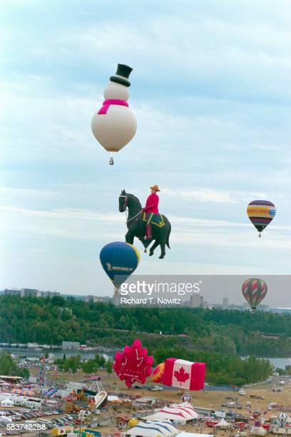 Hot Air Balloons Floating Above Lot