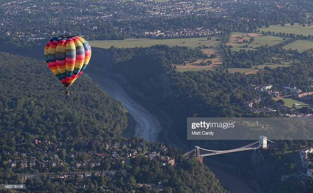 Hot air balloons fly above Bristol from the Bristol International Balloon Fiesta main arena at the Ashton Court estate on August 7, 2015 in Bristol, England. The early morning flight of over 100 balloons was the first mass ascent of the four-day Bristol International Balloon Fiesta which started yesterday. Now in its 37th year, the Bristol International Balloon Fiesta is Europe's largest annual hot air balloon event in the city that is seen by many balloonists as the home of modern ballooning.
