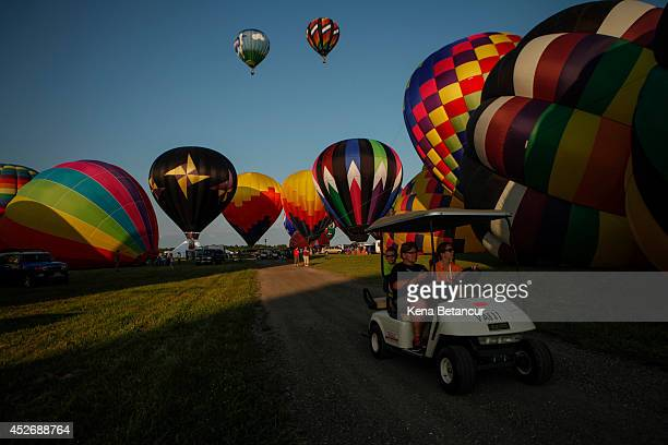 Hot air balloons fly across the sky during the 32nd annual QuickChek New Jersey Festival of Ballooning on July 25 2014 in Readington New Jersey The...