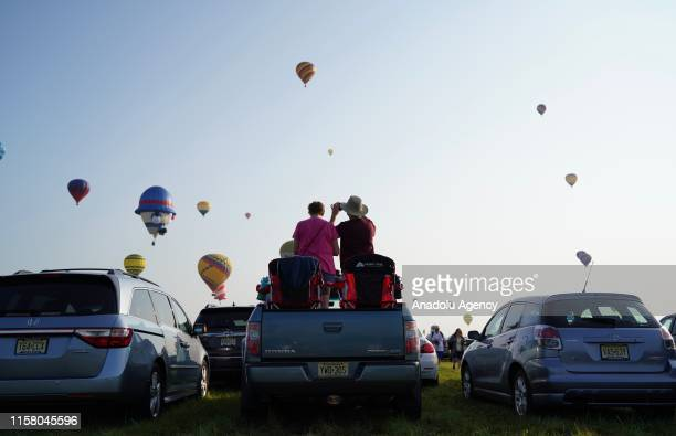 Hot air balloons fly across the sky during the 37nd annual QuickChek New Jersey Festival of Ballooning on July 27 2019 in Readington New Jersey