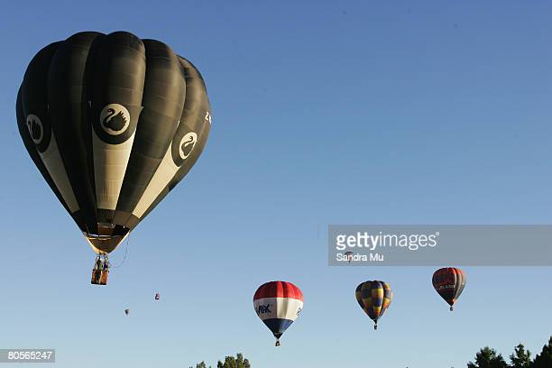 Hot air balloons fly out of Innes Common during the Balloons Over Waikato Festival on April 9 2008 in Hamilton New Zealand The annual Balloons over...
