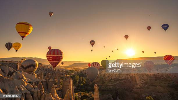 hot air balloons fly over cappadocia - カッパドキア ストックフォトと画像