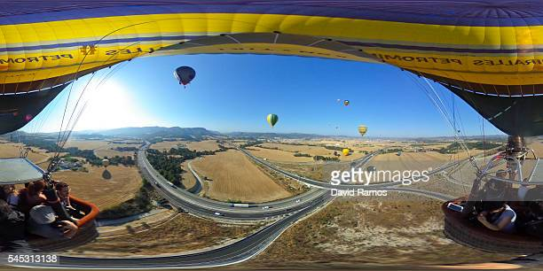 Hot air balloons fly over the city of Igualada on an early flight as part of the European Balloon Festival on July 7 2016 in Igualada Spain Now in...