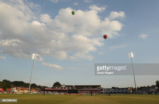 Hot air balloons fly over the County Ground during the Vitality Blast match between Northamptonshire Steelbacks and Nottinghamshire Outlaws at The...