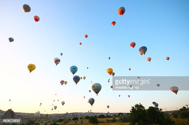 Hot air balloons fly over the famous volcanic rock formations in Cappadocia a historical region in central Anatolia on August 05 2015 in Nevsehir...