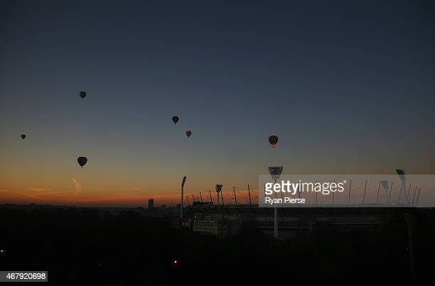 Hot Air Balloons fly over the MCG at sunrise before the 2015 ICC Cricket World Cup final match between Australia and New Zealand at Melbourne Cricket...