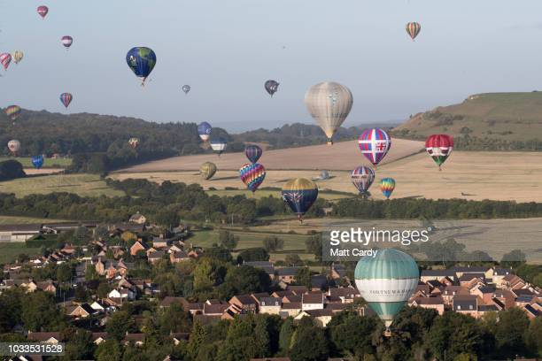 Hot air balloons fly over Warminster as they take to the skies at Longleat's Sky Safari early morning mass ascent at Longleat on September 15 2018...