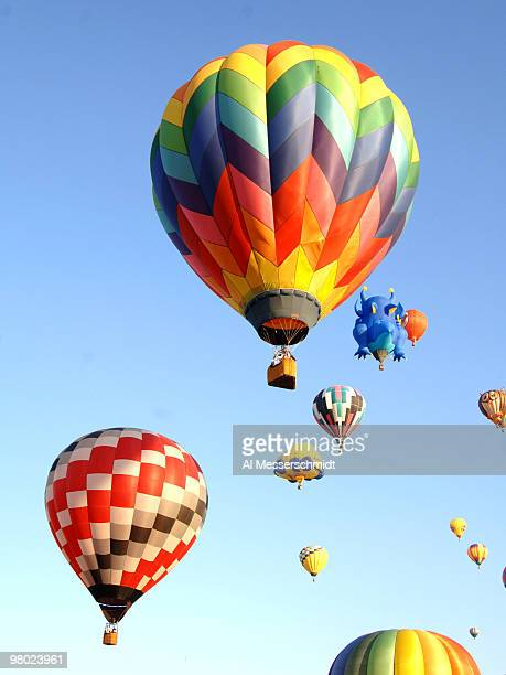 Hot air balloons fly overhead during a morning ascent at the Albuquerque International Balloon Fiesta in Albuquerque New Mexico on October 8 2005