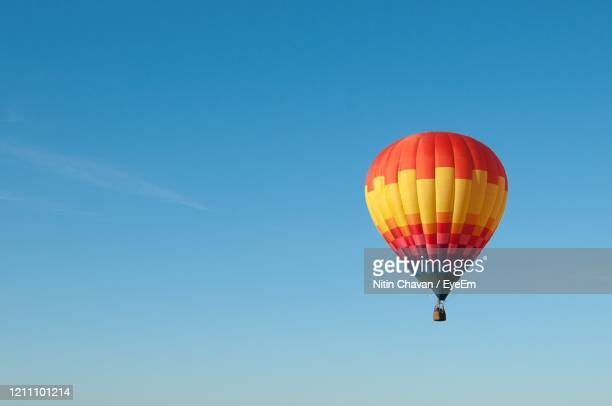 hot air balloons flying at sunset - hot air balloon stock pictures, royalty-free photos & images
