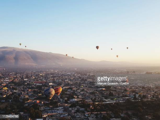 hot air balloons flying in city - central america stock pictures, royalty-free photos & images